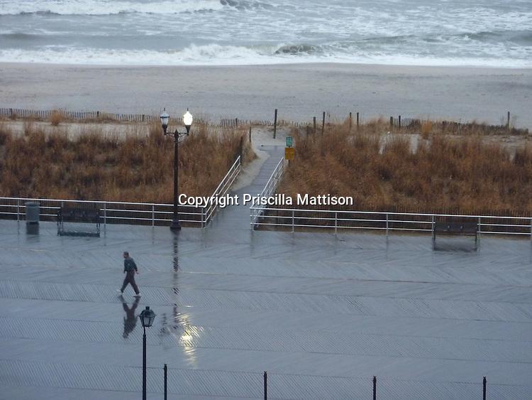 Atlantic City, New Jersey - March 3, 2010:  A man walks the boardwalk early on a wet morning.