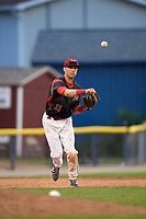 Batavia Muckdogs third baseman Tyler Curtis (11) throws to first base during the first game of a doubleheader against the Mahoning Valley Scrappers on August 28, 2017 at Dwyer Stadium in Batavia, New York.  Mahoning Valley defeated Batavia 6-3.  (Mike Janes/Four Seam Images)