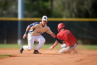 Mount St. Mary's Mountaineers shortstop Patrick Causa (16) attempts to tag Ryan Peltier (7) sliding into second base on a stolen base during a game against the Ball State Cardinals on March 9, 2019 at North Charlotte Regional Park in Port Charlotte, Florida.  Ball State defeated Mount St. Mary's 12-9.  (Mike Janes/Four Seam Images)