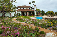 Cistern water storage buried under California garden for water harvest from roof; Urban Water Group design