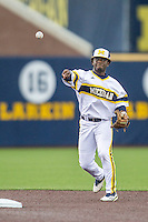 Michigan Wolverines second baseman Ako Thomas (4) makes a throw to first base against the Bowling Green Falcons on April 6, 2016 at Ray Fisher Stadium in Ann Arbor, Michigan. Michigan defeated Bowling Green 5-0. (Andrew Woolley/Four Seam Images)