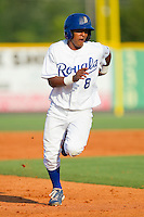 Luis Piterson #8 of the Burlington Royals takes off for third base against the Princeton Rays at Burlington Athletic Stadium July 11, 2010, in Burlington, North Carolina.  Photo by Brian Westerholt / Four Seam Images