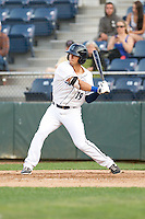 Austin Cousino #19 of the Everett AquaSox at bat during a game against the Salem-Keizer Volcanoes at Everett Memorial Stadium in Everett, Washington on July 9, 2014.  Salem-Keizer defeated Everett 6-4.  (Ronnie Allen/Four Seam Images)