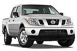 Low aggressive passenger side front three quarter view of a 2009 Nissan Frontier Crew Cab SE.