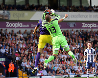 Sunday 01 September 2013<br /> Pictured: Boaz Myhill, goalkeeper for West Brom (13) is grabbing the ball from above Michu of Swansea.<br /> Re: Barclay's Premier League, West Bromwich Albion v Swansea City FC at The Hawthorns, Birmingham, UK.