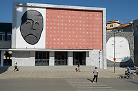 ALBANIA, Korça , theatre with art decorated facade with faces in different moods / ALBANIEN, Korca, Theater mit kuenstlerisch dekorierter Fassade