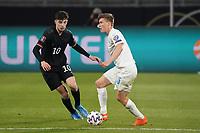 Alsons Sampsted (Island Iceland) gegen Kai Havertz (Deutschland, Germany) - 25.03.2021: WM-Qualifikationsspiel Deutschland gegen Island, Schauinsland Arena Duisburg