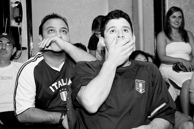 Italy fans watch their team's World Cup match against the United States on June 17, 2006 at L'Angolo, a restaurant in New York City.<br /> <br /> The World Cup, held every four years in different locales, is the world's pre-eminent sports tournament in the world's most popular sport, soccer (or football, as most of the world calls it).  Qualification for the World Cup is open to any country with a national team accredited by FIFA, world soccer's governing body. The first World Cup, organized by FIFA in response to the popularity of the first Olympic Games' soccer tournaments, was held in 1930 in Uruguay and was participated in by 13 nations.    <br /> <br /> As of 2010 there are 208 such teams.  The final field of the World Cup is narrowed down to 32 national teams in the three years preceding the tournament, with each region of the world allotted a specific number of spots.  <br /> <br /> The World Cup is the most widely regularly watched event in the world, with soccer teams being a source of national pride.  In most nations, the whole country is at a standstill when their team is playing in the tournament, everyone's eyes glued to their televisions or their ears to the radio, to see if their team will prevail.  While the United States in general is a conspicuous exception to the grip of World Cup fever there is one city that is a rather large exception to that rule.  In New York City, the most diverse city in a nation of immigrants, the melting pot that is America is on full display as fans of all nations gather in all possible venues to watch their teams and celebrate where they have come from.