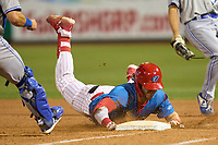 Clearwater Threshers Rixon Wingrove (52) dives back into first base during a game against the Dunedin Blue Jays on May 18, 2021 at BayCare Ballpark in Clearwater, Florida.  (Mike Janes/Four Seam Images)