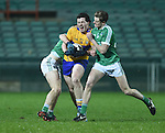 Cathal Downes of Clare  in action against Kieran Daly of Limerick during the Mc Nulty Cup U-21 final at The Gaelic Grounds. Photograph by John Kelly.