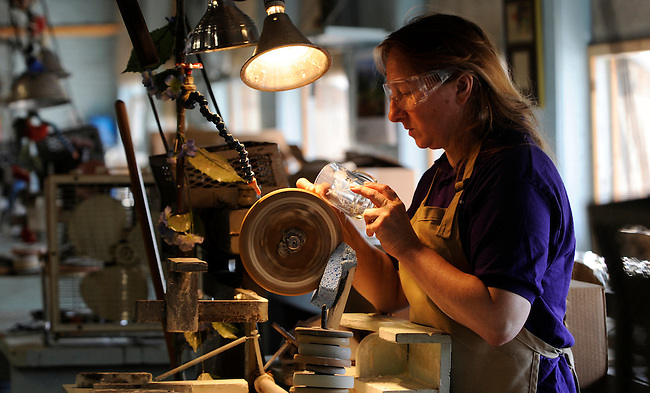 It is as if you have stepped back into time at the Susquehanna Glass works as cutter Christal Synder does her handicraft etching and cutting glassware at the company facility in York, Pa. The Glass works cuts glass by hand to order and does speciality runs for corporate clients around the globe.