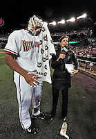 30 September 2009: Washington Nationals' outfielder Justin Maxwell wipes shaving cream off his face during a television interview after a game against the New York Mets at Nationals Park in Washington, DC. The Nationals rallied in the bottom of the 9th inning on Maxwell's walk-off Grand Slam to win 7-4 and sweep the Mets 3-game series capping the Nationals' 2009 home season. Mandatory Credit: Ed Wolfstein Photo