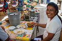 Tlacolula, Oaxaca, Mexico, North America.  Young lady at lunch counter in the market.