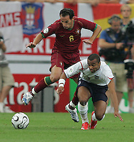 Portuguese midfielder (8) Petit tries to make it past English defender (3) Ashley Cole.  Portugal defeated England on penalty kicks after playing to a 0-0 tie in regulation in their FIFA World Cup quarterfinal match at FIFA World Cup Stadium in Gelsenkirchen, Germany, July 1, 2006.