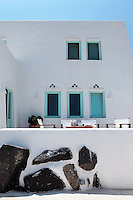 traditional white cottage house..George Karayiannis,  manager if a 5 star hotel on the island of Santorini in Greece, lives in this 200 sqm house which is full of light.