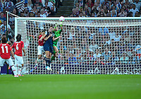 August 09, 2012: United States goalkeeper Hope Solo defends against an attack by Homare Sawa of Japan during Women's Football Final match at the Wembley Stadium on day thirteen in Wembley, England. USA defeat Japan 2-1 to win it's third consecutive Olympic gold medal in women's soccer. ..