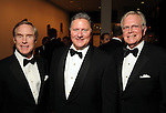 From left: Tommy Smith, Jim Flores and John Adger at the One Great Night in November event at the Museum of Fine Arts Houston Wednesday Nov. 16,2011.(Dave Rossman/For the Chronicle)
