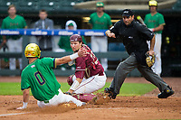 Florida State Seminoles catcher Cal Raleigh (35) puts the tag on Jake Shepski (0) of the Notre Dame Fighting Irish as home plate umpire Olindo Mattia gets in position to make the call in Game Four of the 2017 ACC Baseball Championship at Louisville Slugger Field on May 24, 2017 in Louisville, Kentucky.  The Seminoles walked-off the Fighting Irish 5-3 in 12 innings. (Brian Westerholt/Four Seam Images)