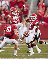 NWA Democrat-Gazette/BEN GOFF @NWABENGOFF<br /> Brooks Ellis (51), Arkansas linebacker, and Jared Collins, Arkansas defensive back, celebrate with DJ Dean (2), Arkansas cornerback, after Dean intercepted a pass intended for Texas Tech running back Justin Stockton in the first quarter on Saturday Sept. 19, 2015 during the game in Razorback Stadium in Fayetteville.