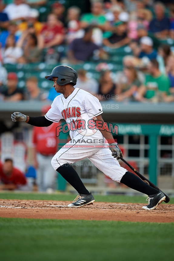 Indianapolis Indians designated hitter Pablo Reyes (12) follows through on a swing during a game against the Rochester Red Wings on July 24, 2018 at Victory Field in Indianapolis, Indiana.  Rochester defeated Indianapolis 2-0.  (Mike Janes/Four Seam Images)