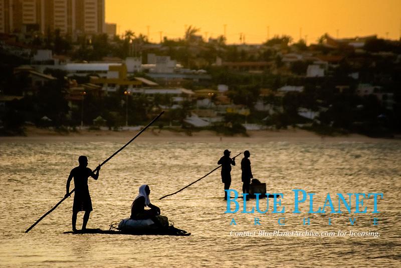 Fishermen in a traditional fishing raft at dusk, Natal, Rio Grande do Norte, Brazil