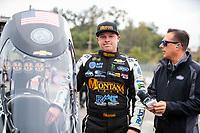 Feb 9, 2020; Pomona, CA, USA; NHRA top fuel driver Austin Prock (left) talks with NHRA announcer Joe Castello during the Winternationals at Auto Club Raceway at Pomona. Mandatory Credit: Mark J. Rebilas-USA TODAY Sports