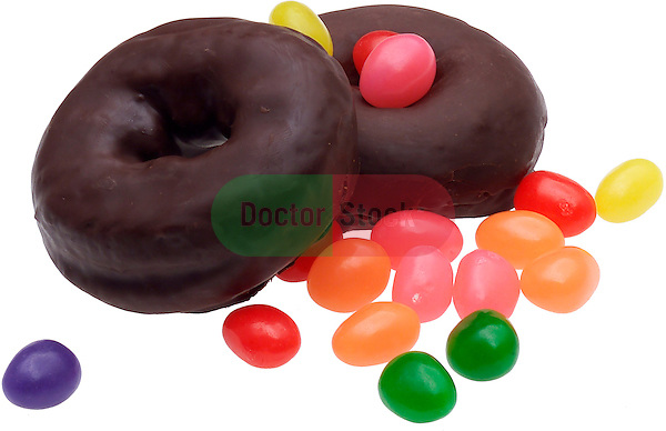 chocolate frosted donuts and jelly beans on shadowless white background