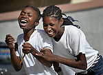 """Girls play together after class at the """"House of Hope,"""" a community-based educational training program in Port-au-Prince, Haiti, for children performing domestic work (so-called 'restaveks'), sponsored by the Ecumenical Foundation for Peace and Justice (FOPJ).  Participants in the program also include former gang members and teenage mothers. Many rights activists consider the use of restaveks to be a modern form of slavery. They are usually children from extremely poor families who are sent away to work as domestic servants in wealthier homes. The children aren't paid for their work, but provided shelter and a sometimes meager meal supply. In the best case scenarios, families will send their restavek children to school. But restaveks often work long days performing a variety of household tasks for nothing more that a meal or two a day. Two-thirds of restaveks are girls, and they are extremely vulnerable to rape and sexual abuse from the families who house and control them. The life of a restavek child in Haiti often varies between bleak and hopeless, and many children never successfully leave their slave conditions. The """"House of Hope,"""" which is supported by Church World Service, a member of the ACT Alliance, has begun to change that cycle of oppression for some restavek children.. (Fondation Oecumenique Pour la Paix et la Justice.)"""