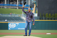 Former New York Yankee great Bernie Williams salutes the crowd prior to throwing out a ceremonial first pitch prior to the International League game between the Scranton/Wilkes-Barre RailRiders and the Charlotte Knights at BB&T BallPark on August 13, 2019 in Charlotte, North Carolina. The Knights defeated the RailRiders 15-1. (Brian Westerholt/Four Seam Images)
