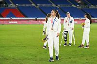 YOKOHAMA, JAPAN - AUGUST 6: Alex Morgan #13 of the United States looks on with her bronze medal during the ceremony at International Stadium Yokohama on August 6, 2021 in Yokohama, Japan.