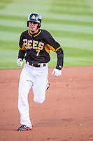Grant Green (7) of the Salt Lake Bees hustles towards third base against the Sacramento River Cats at Smith's Ballpark on April 20, 2015 in Ogden, Utah.  (Stephen Smith/Four Seam Images)