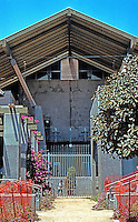 Rob W. Quigley: Sherman Heights Community Center--tighter shot--Maybeckian. Gently sloped pitched roof, patio and offices behind fence. Photo '96.