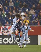 Colorado Rapids midfielder Mehdi Ballouchy (8) and Colorado Rapids midfielder Colin Clark (23) sandwich New England Revolution midfielder Wells Thompson (7) on a head ball. The New England Revolution tied the Colorado Rapids, 1-1, at Gillette Stadium on May 16, 2009.