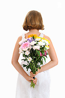 Girl holding bouquet of flowers behind back (Licence this image exclusively with Getty: http://www.gettyimages.com/detail/103301313 )