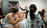 NORFOLK, VA--Assistant Coaches Amy Tucker and Kate Paye congratulate one another after defeating West Virginia University at the Ted Constant Convocation Center at Old Dominion University for the second round of the 2012 NCAA Championships. The Cardinal advanced to the West Regionals in Fresno with a score of 72-55.