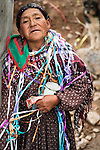 A palliri (woman who works sorting ore outside of a mine) adorned with streamers on the day of Comadres (women's day), during the Miner's Carnaval.