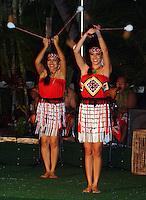 Two Maori girls twirl poi balls at a Polynesian show in Waikiki on O'ahu.