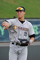 First baseman Aaron Judge (35) of the Charleston RiverDogs warms up before a game against the Greenville Drive on Wednesday, June 11, 2014, at Fluor Field at the West End in Greenville, South Carolina. Judge is the No. 6 prospect of the New York Yankees, according to Baseball America. Greenville won, 6-3. (Tom Priddy/Four Seam Images)