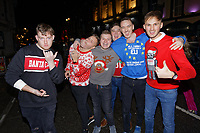 Pictured: Christmas revellers in Wind Street, Swansea, Wales, UK. Friday 20 December 2019<br /> Re: Black Eye Friday (also known as Black Friday, Mad Friday, Frantic Friday) the last Friday before Christmas, in Swansea, Wales, UK.