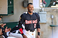 Tony Thomas (2) of the New Britain Rock Cats smiles in the dugout after hitting a home run during a game against the Trenton Thunder at New Britain Stadium on May 7, 2014 in New Britain, Connecticut.  Trenton defeated New Britain 6-4.  (Gregory Vasil/Four Seam Images)