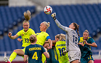TOKYO, JAPAN - JULY 24: Caroline Seger #10 of Sweden goes up in the box as Teagan Micah #18 of Australia punches the ball during a game between Australia and Sweden at Saitama Stadium on July 24, 2021 in Tokyo, Japan.