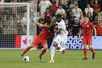 KANSAS CITY, KANSAS - JUNE 26: Christian Pulisic #10, Michael Murillo #23 during a 2019 CONCACAF Gold Cup group D match between the United States and Panama at Children's Mercy Park on June 26, 2019 in Kansas City, Kansas.