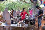 Auroville, India - April 2021: Human Unity in Covid Time. Cooking for the opening night of the Auroville Film Festival