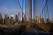 April 21, 2020<br /> Brooklyn, New York<br /> <br /> A lone runner on the Brooklyn Bridge at dawn during the height of the coronavirus pandemic.