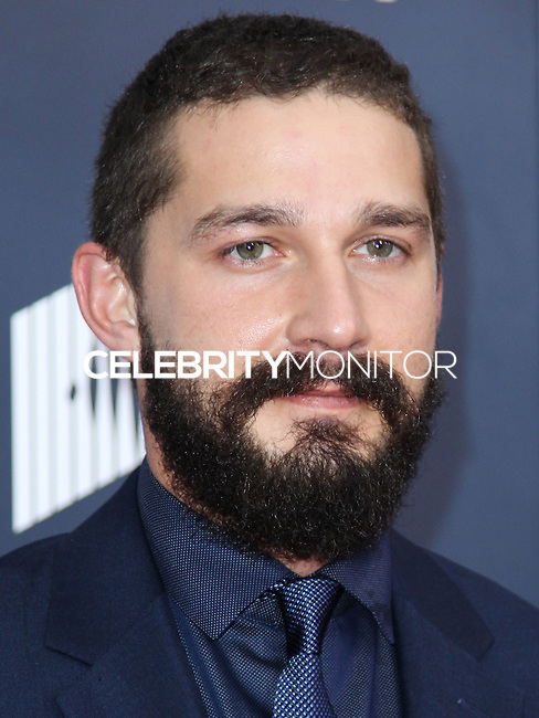 WASHINGTON, DC, USA - OCTOBER 15: Shia Labeouf arrives at the Washington DC Premiere Of Sony Pictures' 'Fury' held at The Newseum on October 15, 2014 in Washington, DC, United States. (Photo by Jeffery Duran/Celebrity Monitor)