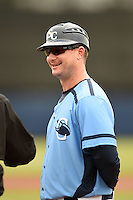 Charlotte Stone Crabs manager Jared Sandberg (22) during the lineup exchange before a game against the Fort Myers Miracle on April 16, 2014 at Charlotte Sports Park in Port Charlotte, Florida.  Fort Myers defeated Charlotte 6-5.  (Mike Janes/Four Seam Images)