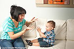 12 month old baby boy playing singing game with hand gestures