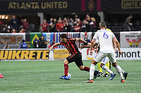 ATLANTA, GA - MARCH 07: ATLANTA, GA - MARCH 07: Atlanta United midfielder Eric Remedi dribbles the ball during the match against FC Cincinnati, which Atlanta won, 2-1, in front of a crowd of 69,301 at Mercedes-Benz Stadium during a game between FC Cincinnati and Atlanta United FC at Mercedes-Benz Stadium on March 07, 2020 in Atlanta, Georgia.