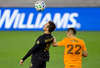 CARSON, CA - OCTOBER 28: Danny Musovski #16 of the Los Angeles FC heads a ball during a game between Houston Dynamo and Los Angeles FC at Banc of California Stadium on October 28, 2020 in Carson, California.