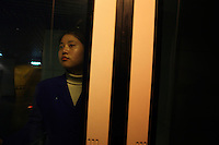 CHINA. Shanghai. An attendant stands at the entrance to the Bund Sightseeing tunnel that runs underneath the Huangpu River from the Bund to Pudong. 2008.